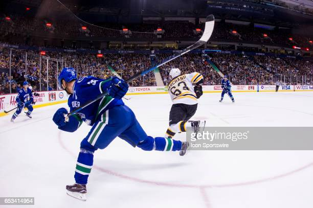 Boston Bruins Left Wing Brad Marchand skates away from Vancouver Canucks Center Henrik Sedin during a NHL hockey game on March 13 at Rogers Arena in...
