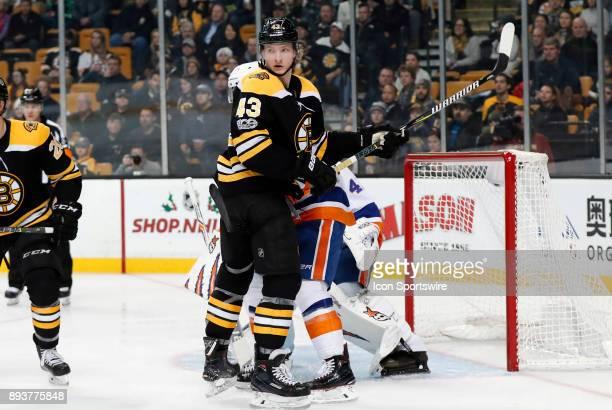 Boston Bruins left wing Danton Heinan in front of New York Islanders goalie Jaroslav Halak during a game between the Boston Bruins and the New York...
