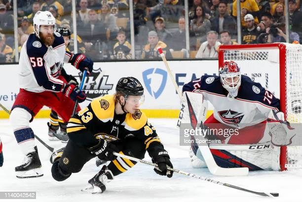Boston Bruins left wing Danton Heinan tries to put a shot on Columbus Blue Jackets goalie Sergei Bobrovsky during Game 2 of the Second Round 2019...