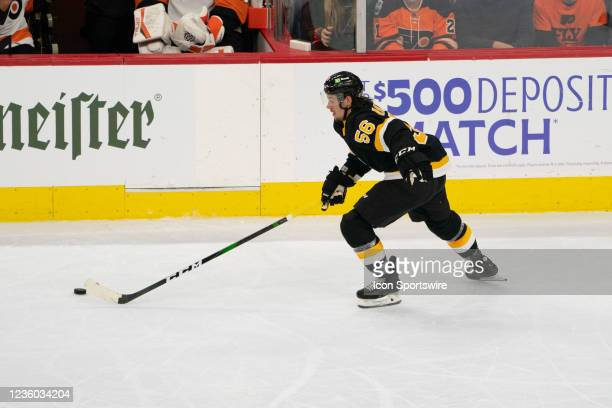 Boston Bruins Left Wing Erik Haula skates with the puck during the second period of a National Hockey League game between the Boston Bruins and the...