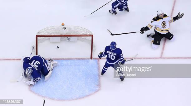 TORONTO ON APRIL 21 Boston Bruins left wing Jake DeBrusk celebrates after scoring on Toronto Maple Leafs goaltender Frederik Andersen in the second...