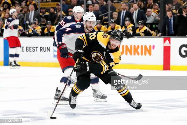 Boston Bruins left wing Joakim Nordstrom gets past Columbus Blue Jackets defenseman Scott Harrington during Game 2 of the Second Round 2019 Stanley...
