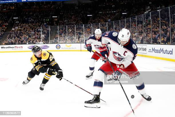 Boston Bruins left wing Joakim Nordstrom knocks the puck from Columbus Blue Jackets left wing Nick Foligno during Game 1 of the Second Round 2019...