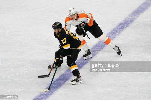 Boston Bruins Left Wing Nick Foligno skates with the puck with Philadelphia Flyers Left Wing Oskar Lindblom defending during the second period of a...