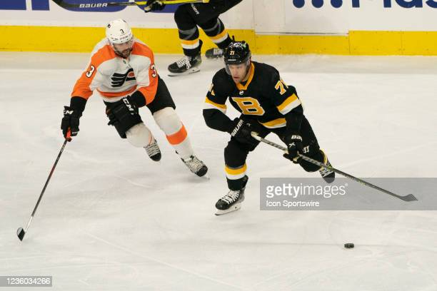 Boston Bruins Left Wing Taylor Hall skates with the puck with Philadelphia Flyers Defenseman Keith Yandle in pursuit during the second period of a...