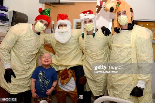 Boston Bruins Patrice Bergeron Anders Bjork Noel Acciari and Tim Schaller visit with Lucas at Boston Children's Hospital December 11 2017 in Boston...