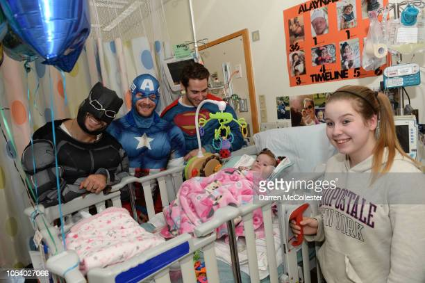 Boston Bruins Patrice Bergeron Chris Wagner and John Moore visit with Alaynas at Boston Children's Hospital October 26 2018 in Boston Massachusetts