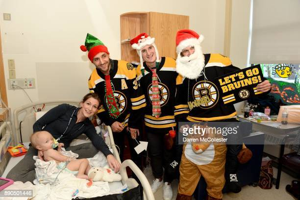 Boston Bruins Patrice Bergeron Noel Acciari and Anders Bjork visit with Henry and Mom at Boston Children's Hospital December 11 2017 in Boston...