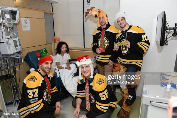 Boston Bruins Patrice Bergeron Noel Acciari Tim Schaller and Ander Bjork visit with Yamilka at Boston Children's Hospital December 11 2017 in Boston...