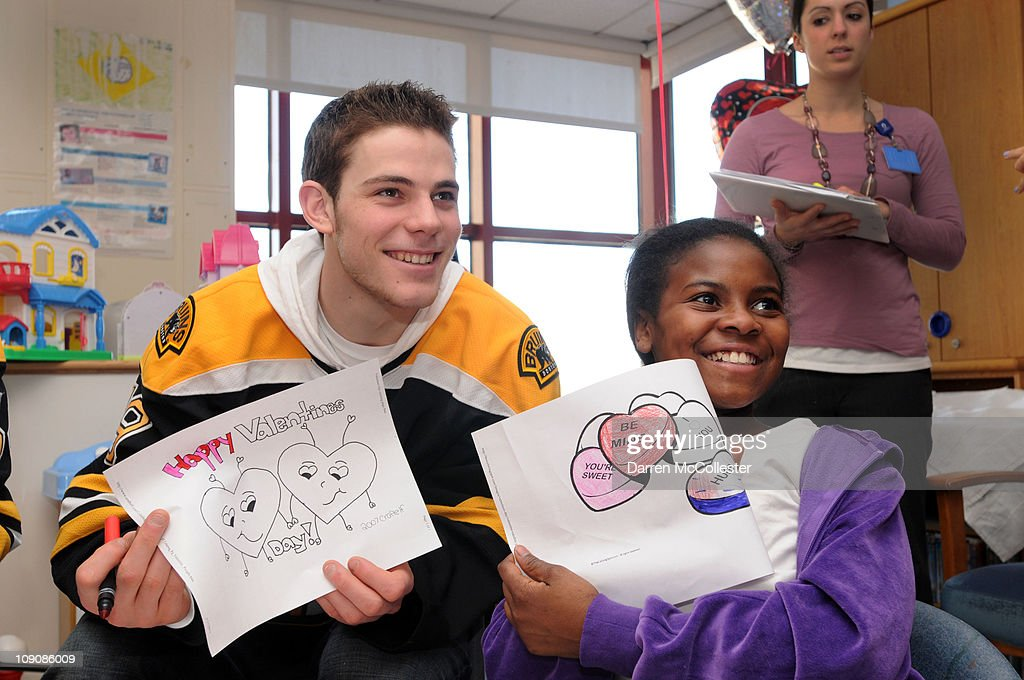 Boston Bruins player Tyler Seguin spreads Valentine's Day cheer for patient Dominique February 14, 2011 at Children's Hospital Boston in Boston, Massachusetts.
