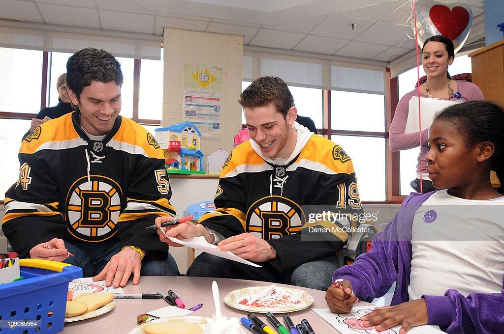 Boston Bruins players Adam McQuaide (L) and Tyler Seguin spread Valentine's Day cheer for patient Dominique February 14, 2011 at Children's Hospital Boston in Boston, Massachusetts.