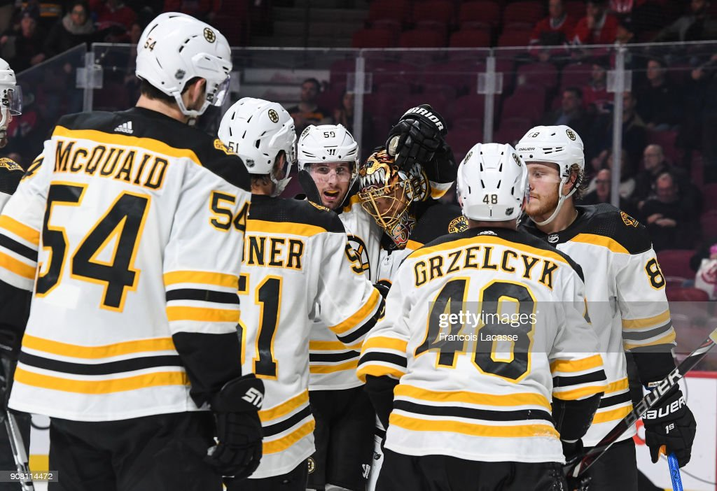 Boston Bruins Players Celebrate After Defeating The Montreal Canadiens In NHL Game At Bell