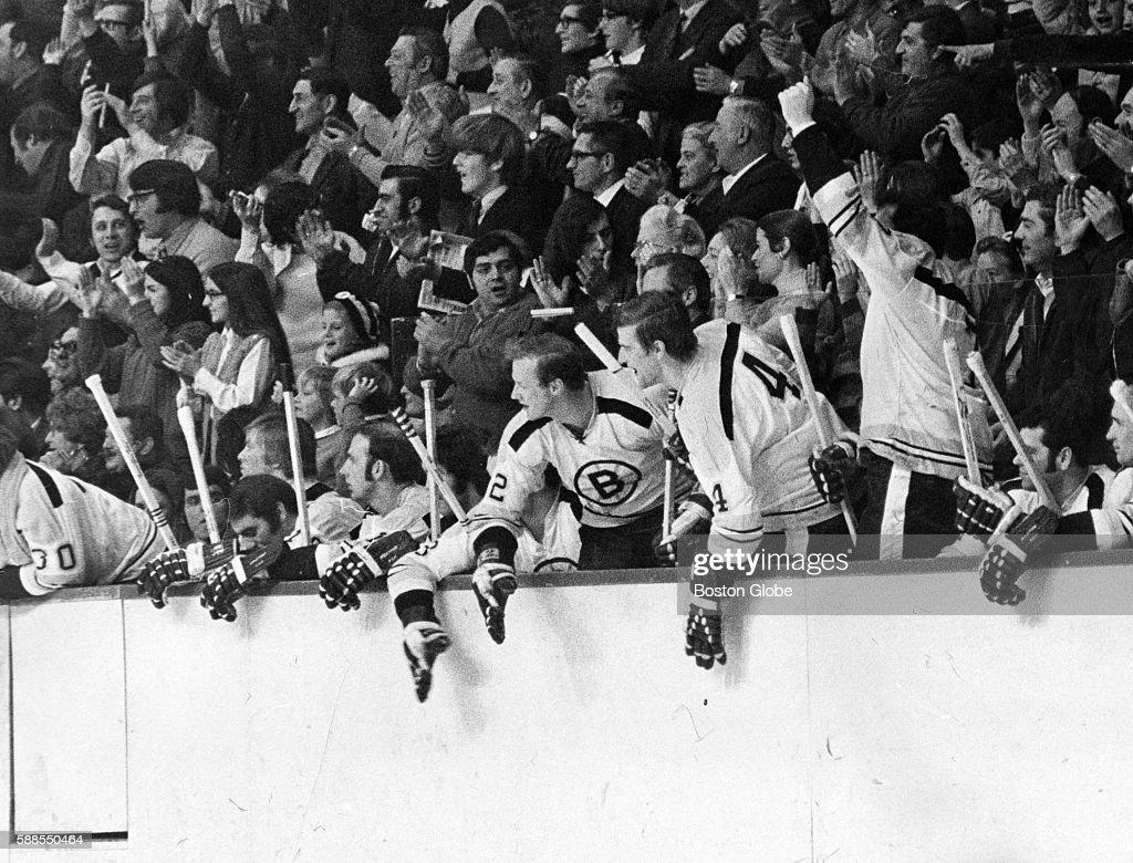 Boston Bruins Players Wayne Cashman Bobby Orr And Phil Esposito Celebrate Teammates Ray Leachs