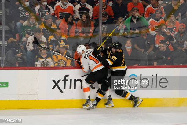 Boston Bruins Right Defenseman Brandon Carlo checks Philadelphia Flyers Center Derick Brassard into the boards during the second period of a National...