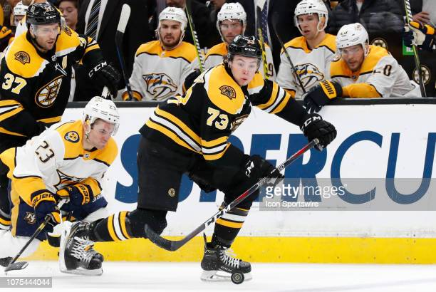 Boston Bruins right defenseman Charlie McAvoy beats Nashville Predators winger Rocco Grimaldi during a game between the Boston Bruins and the...