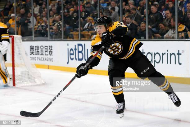 Boston Bruins right defenseman Charlie McAvoy passes the puck up ice during a game between the Boston Bruins and the Washington Capitals on December...