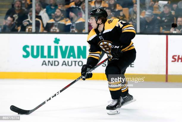Boston Bruins right defenseman Charlie McAvoy skates up ice with the puck during a game between the Boston Bruins and the New York Islanders on...