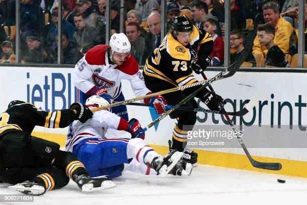 Boston Bruins right defenseman Charlie McAvoy takes the puck from Montreal Canadiens center Jacob De La Rose during a game between the Boston Bruins...