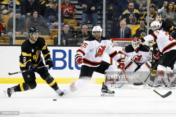 Boston Bruins right defenseman Colin Miller looks to the other point on the power play during a regular season NHL game between the Boston Bruins and...