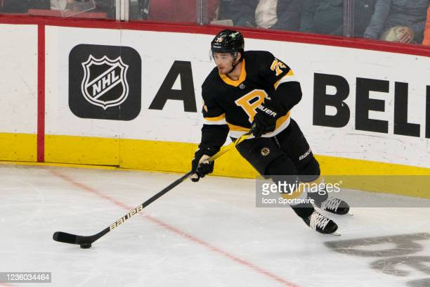Boston Bruins Right Defenseman Connor Clifton skates with the puck during the second period of a National Hockey League game between the Boston...