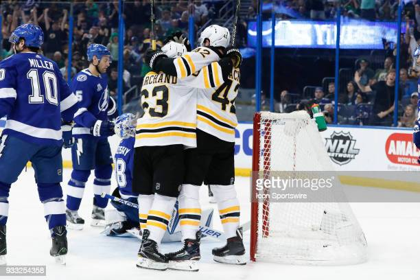 Boston Bruins right wing David Backes celebrates with Boston Bruins left wing Brad Marchand after scoring a goal in the first period of the NHL game...