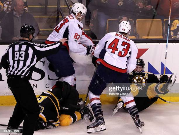 Boston Bruins right wing David Backes is knocked to the ice by Washington Capitals right wing Tom Wilson after Backes came to the aid of Boston...
