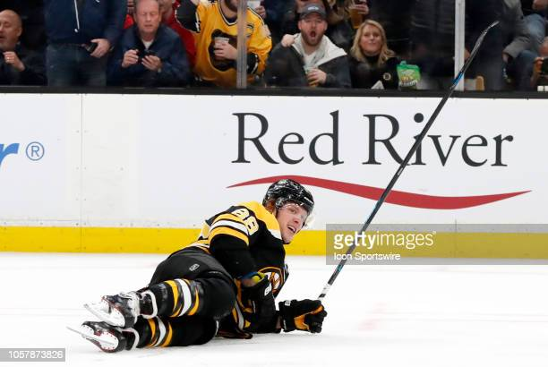 Boston Bruins right wing David Pastrnak lands on the ice after scoring during a game between the Boston Bruins and the Dallas Stars on November 5 at...