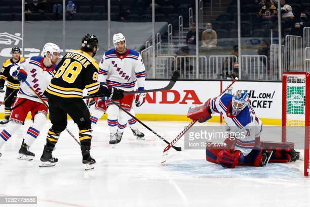 Boston Bruins right wing David Pastrnak scores his 200th goal past New York Rangers goalie Keith Kinkaid during a game between the Boston Bruins and...
