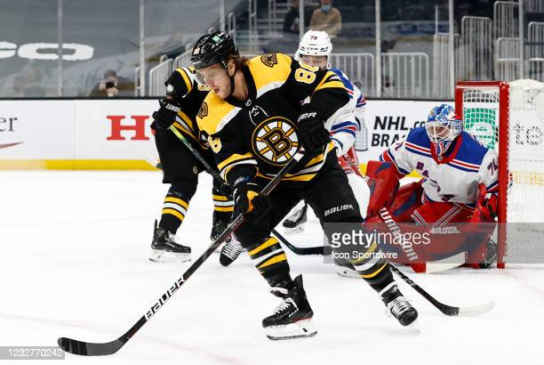 Boston Bruins right wing David Pastrnak sets up a backhand during a game between the Boston Bruins and the New York Rangers on May 8 at TD Garden in...