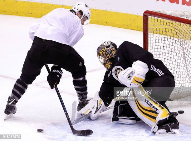 Boston Bruins right wing David Pastrnak tries a betweenthelegs shot attempt on Boston Bruins goaltender Anton Khudobin during Boston Bruins practice...