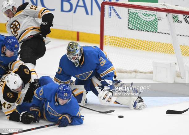 Boston Bruins rightwing David Backes tries to poke a shot past St Louis Blues goalie Jordan Binnington during a NHL game between the Boston Bruins...