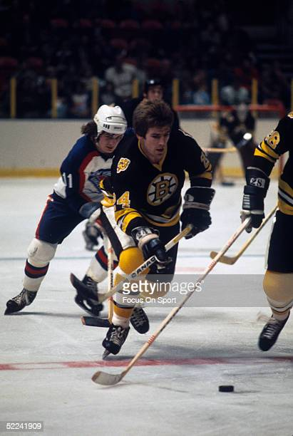Boston Bruins' Terry O'Reilly skates with the puck during a game against the New York Rangers at Madison Square Garden circa 1982 in New York New York