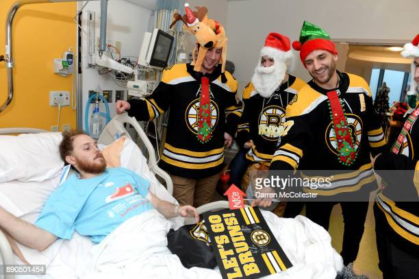 Boston Bruins Tim Schaller Anders Bjork and Patrice Bergeron visit with Charles at Boston Children's Hospital December 11 2017 in Boston Massachusetts
