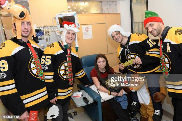 Boston Bruins Tim Schaller Noel Acciari Ander Bjork and Patrice Bergeron visit with Kelly at Boston Children's Hospital December 11 2017 in Boston...
