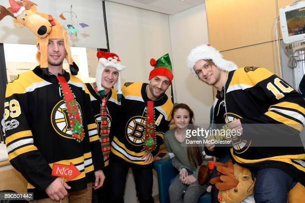 Boston Bruins Tim Schaller Noel Acciari Patrice Bergeron and Ander Bjork visit with Caira at Boston Children's Hospital December 11 2017 in Boston...