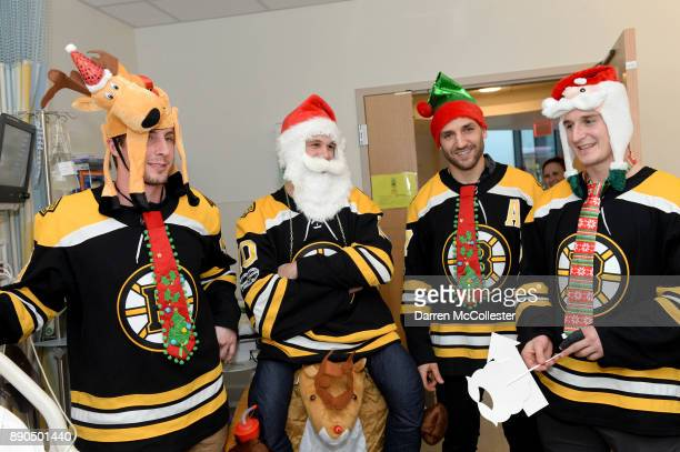 Boston Bruins Tim Schallers Anders Bjork Patrie Bergeron and Noel Acciari visit the kids Boston Children's Hospital December 11 2017 in Boston...
