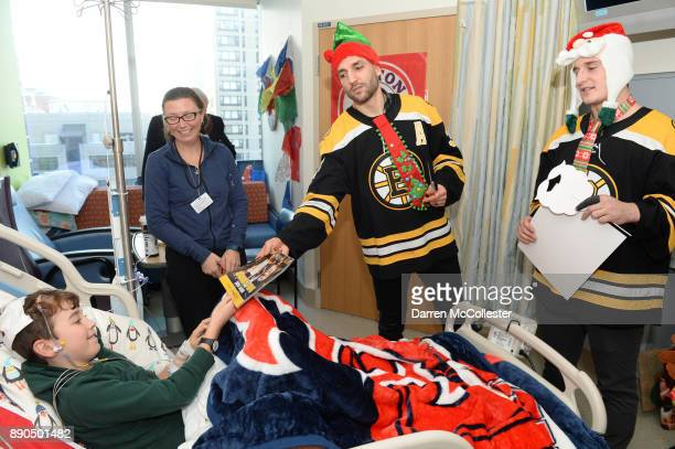 Boston Bruins visit with Patrice Bergeron and Noel Acciari visit Graham and Mom at Boston Children's Hospital December 11 2017 in Boston Massachusetts