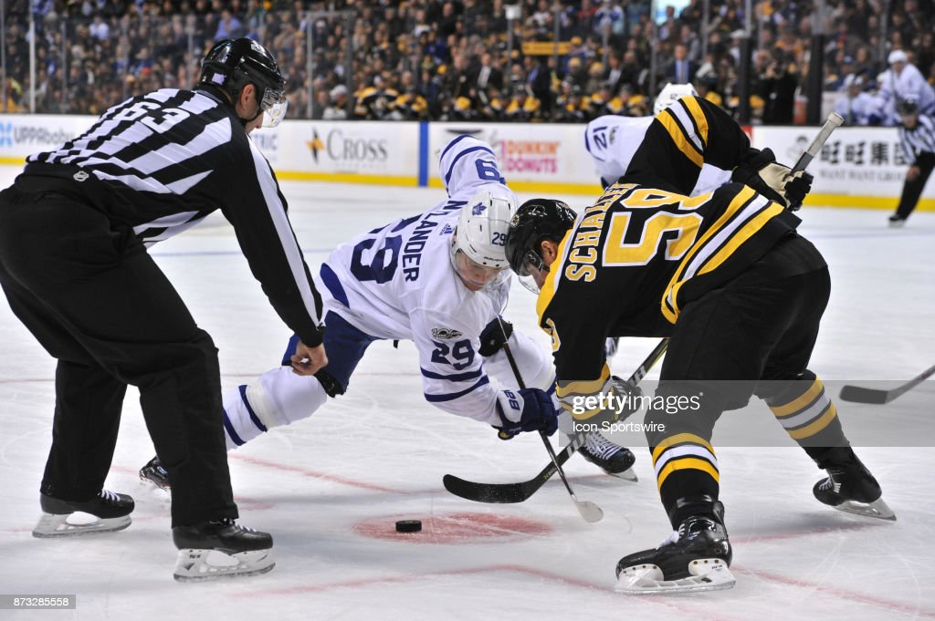 Boston Bruins Winger Tim Schaller (59) and Toronto Maple Leafs Right Wing William Nylander (29) battle for the puck on the face off. During the Boston Bruins game against the Toronto Maple Leafs on November 11, 2017 at TD Bank Garden in Boston, MA.