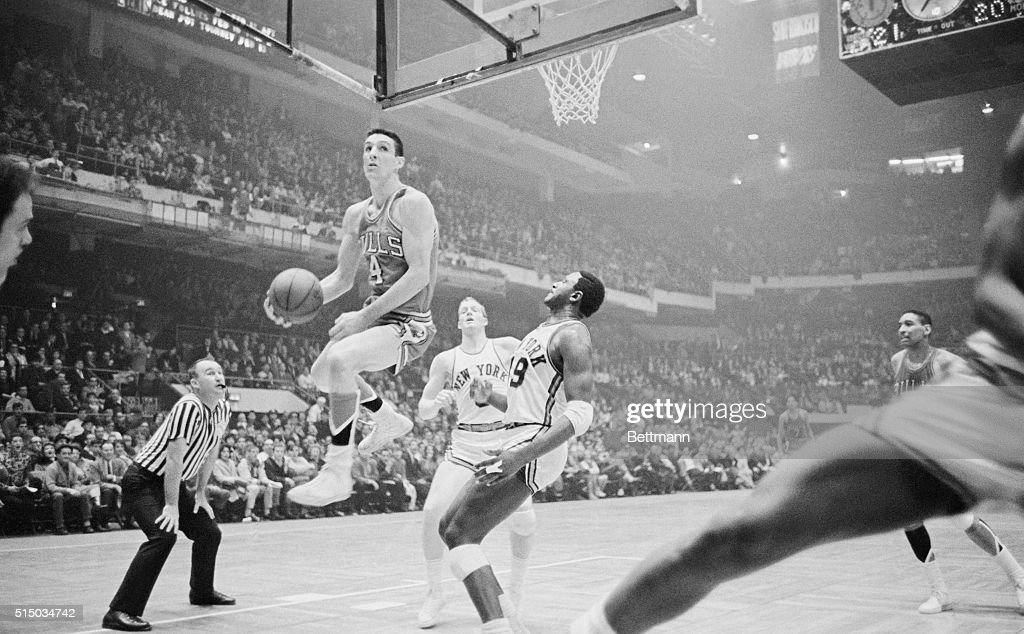 Jerry Sloan Jumping for the Basket : News Photo