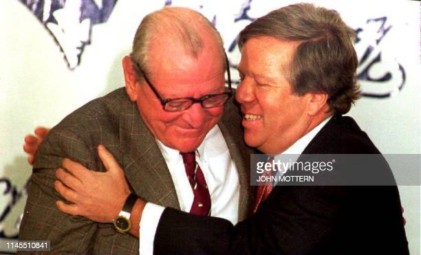 Boston businessman Robert Kraft hugs James Orthwein during a press conference in Boston, MA, concerning his purchase of the New England Patriots...