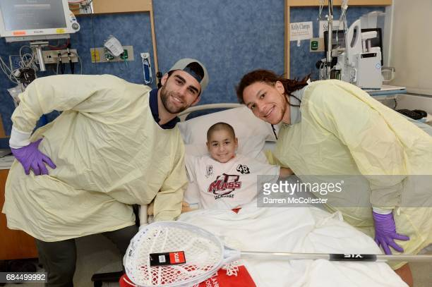Boston Cannons James Fahey and Josh Hawkins visit Mateo at Boston Children's Hospital on May 18 2017 in Boston Massachusetts