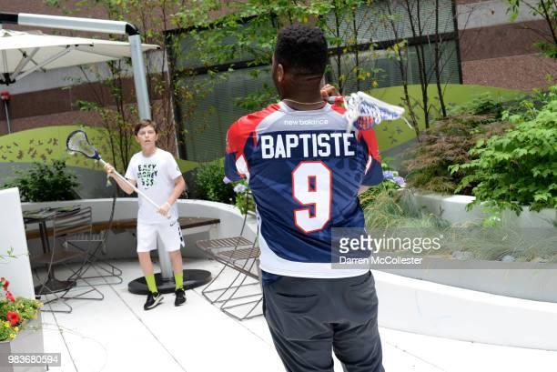 Boston Cannons Trevor Baptiste and Kyle Denhoff visit Paul at Boston Children's Hospital June 25 2018 in Boston Massachusetts