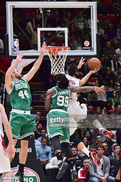 Boston Celtic forward Jae Crowder fights for the ball with Emporio Armani Milano guard Alessandro Gentile during their NBA Gloabal Games match...