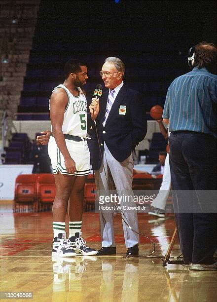 Boston Celtic great Bob Cousy in blue blazer interviews Celtic point guard John Bagley during a pregame report Hartford CT 1992