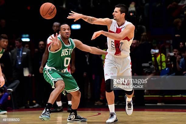Boston Celtic guard Avery Bradley fights for the ball with Emporio Armani Milano guard Andrea Cinciarini during their NBA Gloabal Games match Emporio...