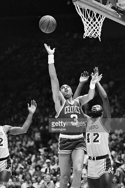 Boston Celtic guard Dennis Johnson goes up for a shot as Los Angeles Laker forward James Worthy tries to defend him during 1st quarter action...