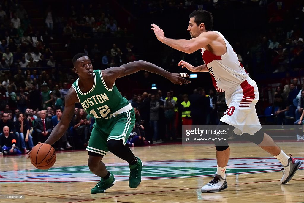 Boston Celtic guard Terry Rozier (L) fights for the ball with Emporio Armani Milano guard Andrea Cinciarini during their NBA Gloabal Games match Emporio Armani Milano VS Boston Celtic on October 06, 2015 at the Mediolanum Forum in Assago.