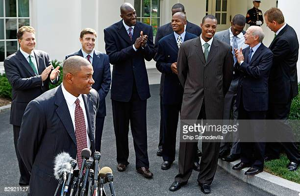 Boston Celtic head coach Doc Rivers talks to reporters outside the West Wing with with team managing partner Steve Pagliuca team coowner Wycliffe Wyc...