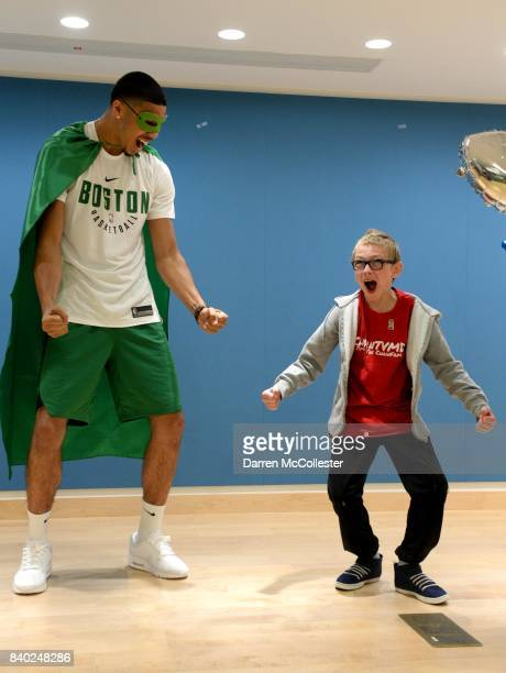 Boston Celtic Jayson Tatum and Matthias show of their superhero poses during Day of Joy Celebration at Boston Children's Hospital August 28 2017 in...