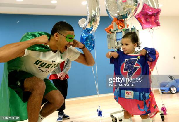 Boston Celtic Jayson Tatum and Whitney show of their superhero poses at Boston Children's Hospital August 28 2017 in Boston Massachusetts